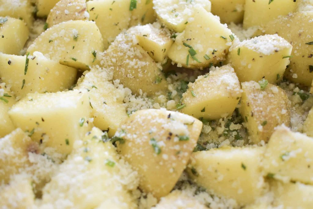 a photo of herb garlic parmesan potatoes before they are roasted in the oven