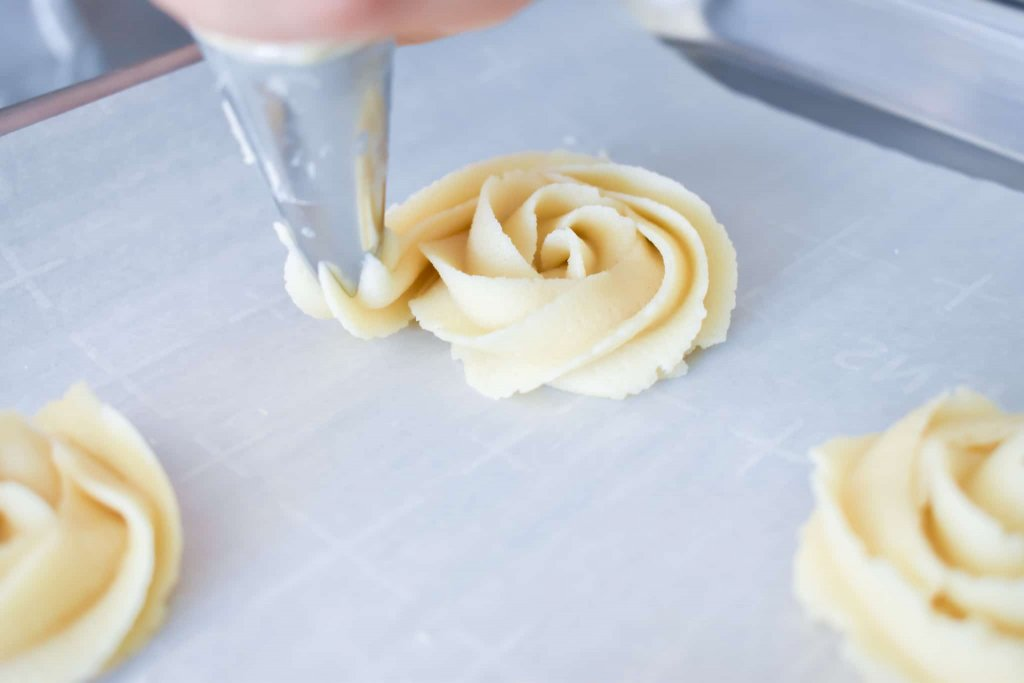 photo of a rosette butter cookie being piped