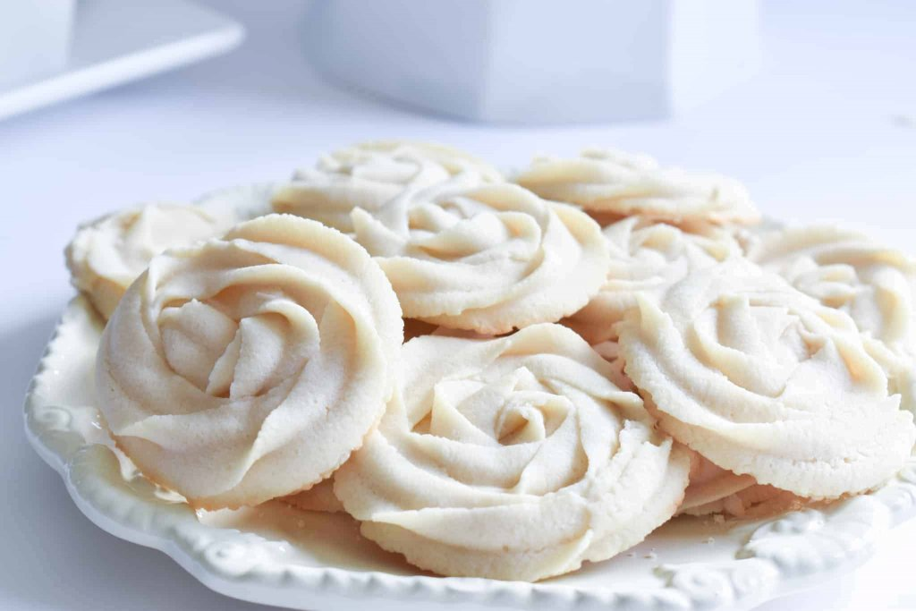 a plate full of whipped rosette butter cookies