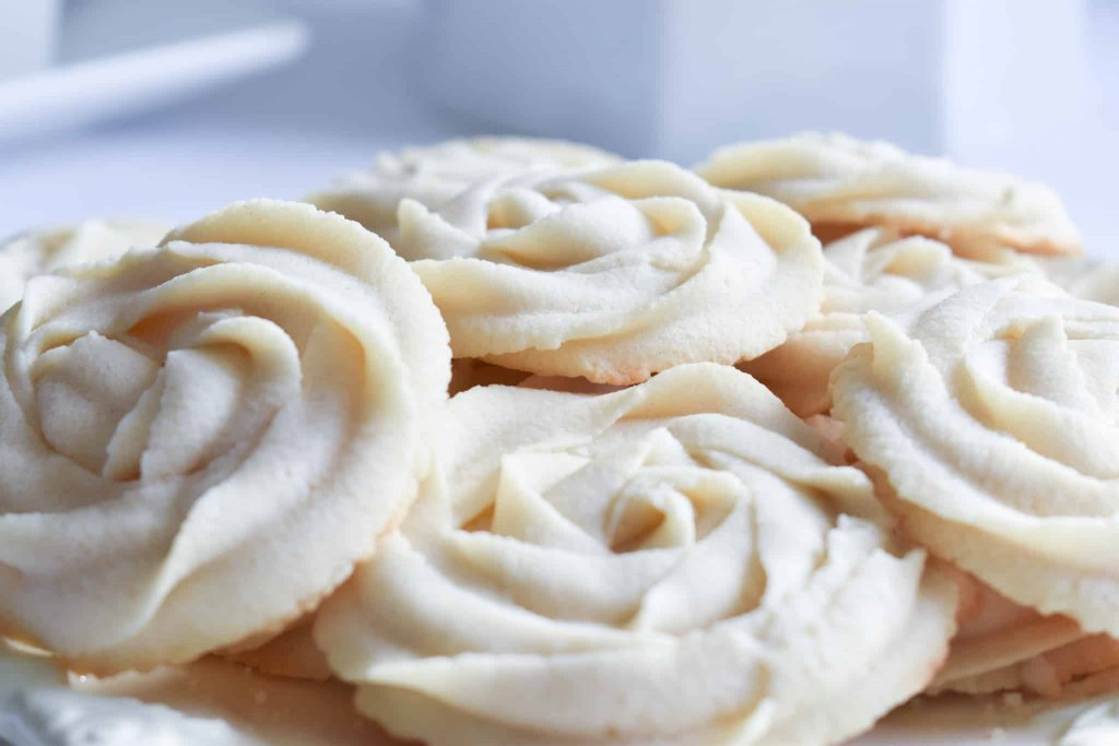 an close-up shot of whipped rosette butter cookies on a plate