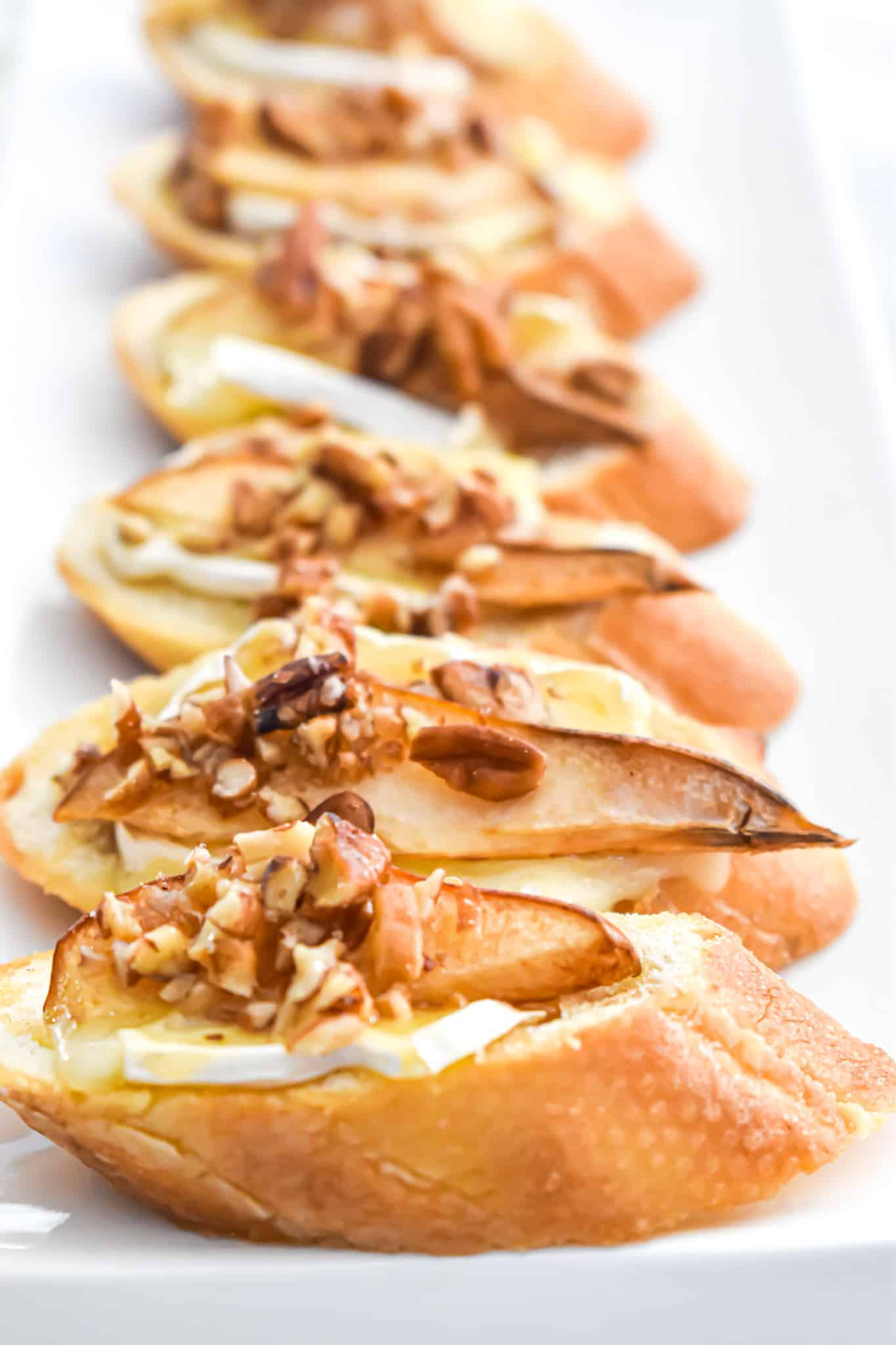 Brie Cheese with Pear, Pecan and Honey Crostini