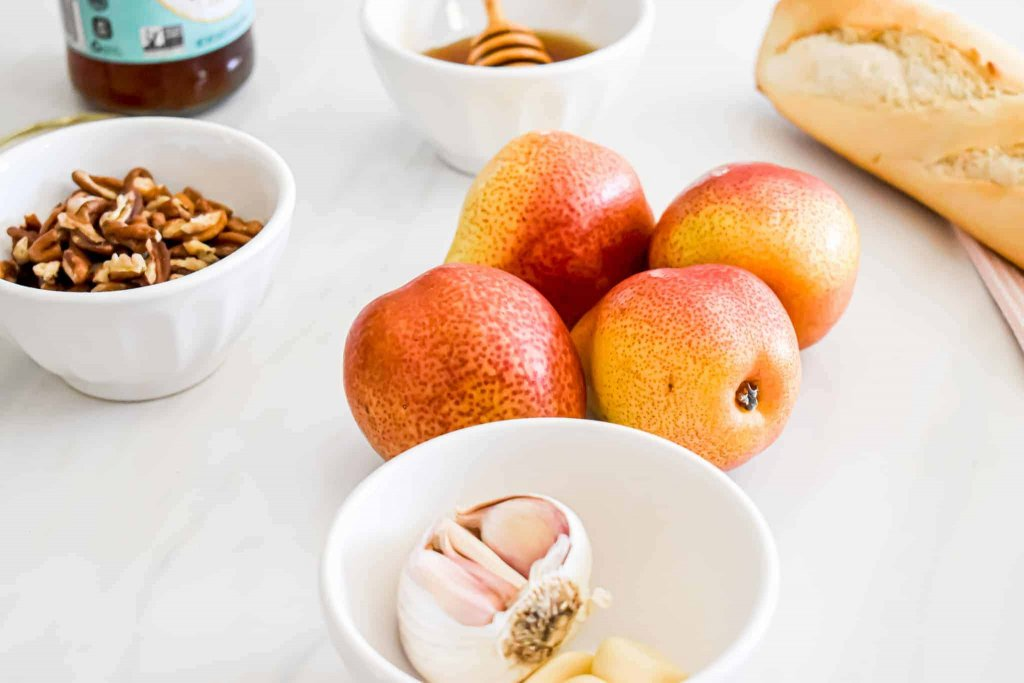 photo of pears with garlic, baguette, pecans and honey