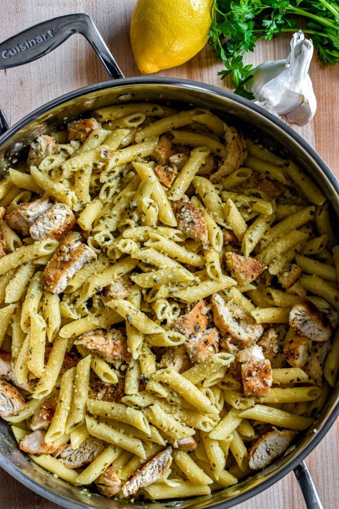 family style lemon garlic chicken pasta served in a large cooking pan