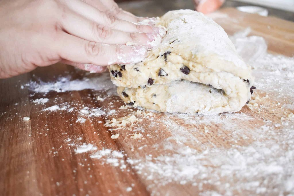 scone dough being folded over to create layers