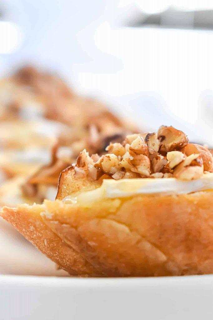 photo of brie cheese with pear and pecan and honey crostini
