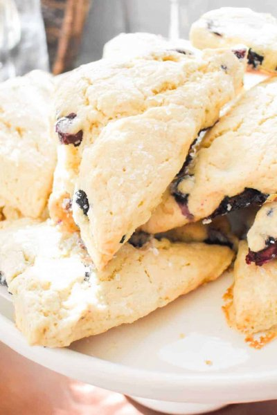 A cake stand with blueberry scones