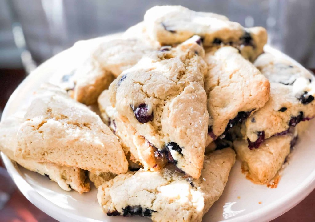 Blueberry scones on a white cake stand